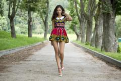 Young woman in color dress Stock Photos