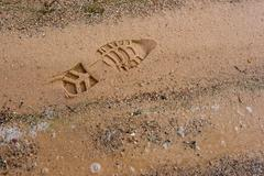 boot imprint on the beach sand - stock photo