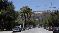 Famous Landmark Iconic Hollywood Sign, Los Angeles Street, Car Traffic Passing Stock Footage