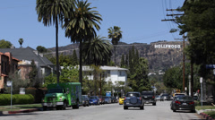 Hollywood Sign Santa Monica Mountains Los Angeles Street Car Traffic Palm Trees - stock footage