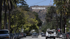 Los Angeles Neighborhood Hollywood Sign Rich People Houses Cars Passing Sunny Stock Footage