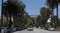 Hollywood Sign Los Angeles Entertainment World Symbol Cars Passing Palm Trees Footage