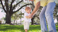 Young Father Swinging Cute Little Caucasian Boy Air Stock Footage