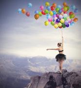 Dancer with balloons Stock Photos