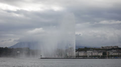 Fountain on Lake Geneva shore in cloudy day Stock Footage