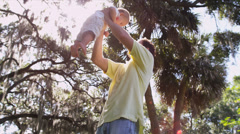 Young Caucasian Father Holding Son High Up Arms - stock footage