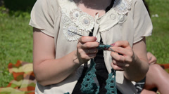 Womans hand crocheted from a quick light blue thread Stock Footage