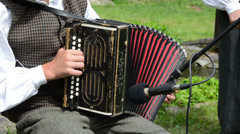 Accordionist young man play folk music with accordion Stock Footage