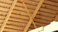 529 under cedar wooden shingles roof roofing roofworking carpenty totally sol Stock Footage