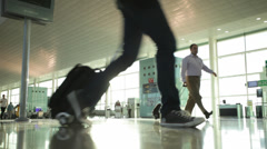 Passengers with luggage in modern European airport Stock Footage