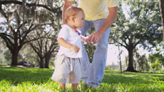 Father Little Caucasian Boy Toddler Barefoot Outdoors Grass - stock footage