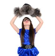 Tricke girl taking fur hat of his head Stock Photos