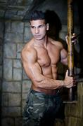 Handsome muscleman shirtless wearing military pants Stock Photos