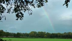 Stock Video Footage of Rainbow Landscape with storm clouds