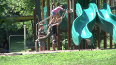 Children at playground at park  Stock Footage