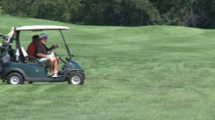 Golf cart driving along course - stock footage