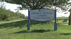 Edward Yeomans Complex at Short Beach Park sign  Stock Footage