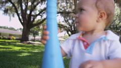 Happy Little Boy Walking Park Toy Baseball Bat Stock Footage