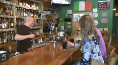 Woman and young man being served sodas at bar  Stock Footage