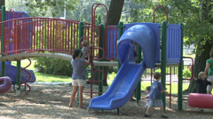 Moms and toddlers at playground Stock Footage