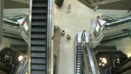 Stock Video Footage of Top view of elevators and escalators moving within mall (2 of 2)