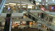 Stock Video Footage of Shoppers moving through mall on escalators