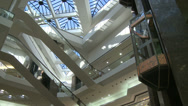 Stock Video Footage of Watching elevator descend from glass ceiling within mall (2 of 2)