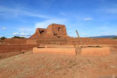 Spanish church and native kiva - stock photo