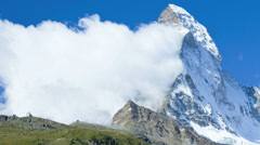 Motion time lapse Matterhorn Summit view of banner cloud, Zermatt Stock Footage