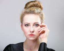young beautiful girl make up and hair bun - stock photo