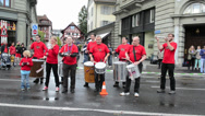 Stock Video Footage of musicians lined the streets of Lucerne and play traditional song to cheer up