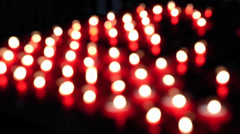 Lots of red church candles Stock Footage