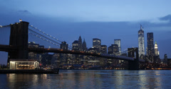 Ultra HD 4K Brooklyn Bridge, New York City One WTC World Trade Center Night Dusk Stock Footage