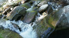 Clear water flowing over stones. Stock Footage
