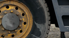 Big truck wheel tires of a construction equipment Stock Footage