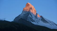 Motion time lapse sun rising Matterhorn, Zermatt Stock Footage