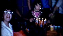 10 year old girl blowing out birthday candles vintage fashion celebration Stock Footage