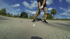 Golfer plays out of Sand Trap - stock footage