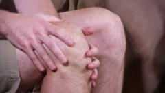 4K Aching Knee Pain Rub 3759 Stock Footage