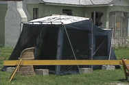 Stock Video Footage of CU tent in front of damaged Hse, ZO pan to other damaged house, Hurricane Andrew