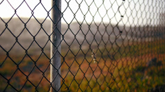 Los Angeles Urban Chain Link Fence With Sand Dune and Fog in Bokeh - stock footage