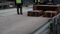559 piled blocks equipments of wood and men walking away from it Stock Footage