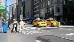 New York City Taxis and Pedestrians Stock Footage