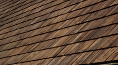 570 cedar wooden shingles roof roofing roofworking taring Stock Footage