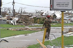Disaster, Stunned man walks through destroyed trailer park, Hurrican eAndrew - stock footage
