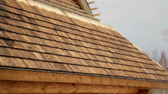 571 cedar wooden shingles shake roof roofing roofworking  Stock Footage