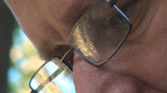 Portrait of Man Reading Newspaper, Closeup of Caucasian Blue Eyes in Spectacles Stock Footage