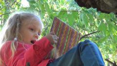 Little Girl Reading, Playing with Storybook, Child with Book in Forest, Children - stock footage