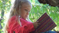 Little Girl Reading, Playing with Storybook, Child with Book in Forest, Children Stock Footage