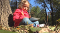 Child Playing at Tablet Device in Park, Girl Using Touchscreen Ipad, Children Footage